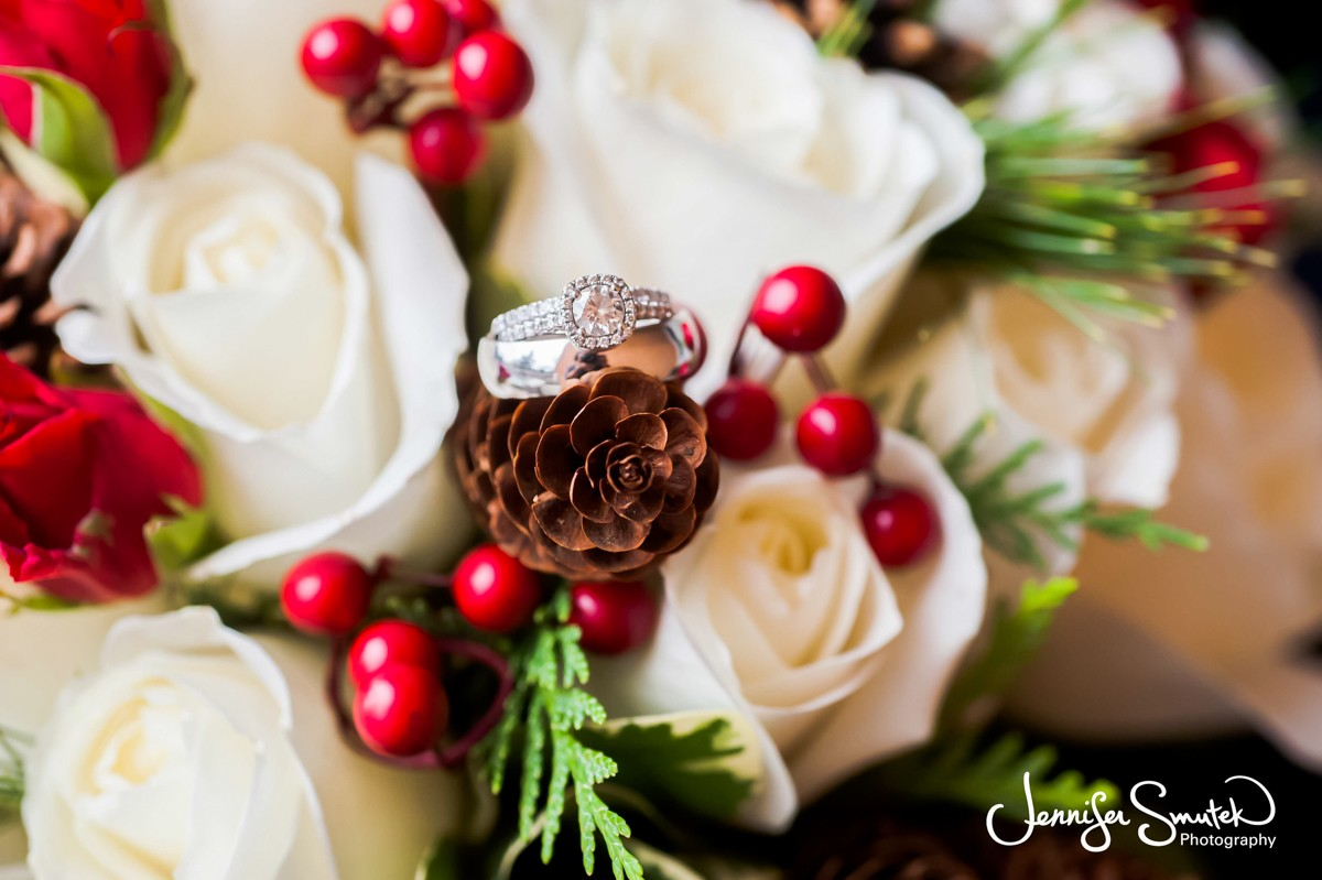 Wedding rings on winter bridal flowers