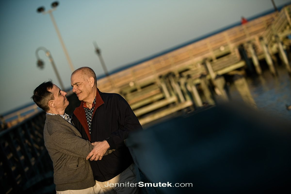 two men standing in full sun at the north beach boardwalk