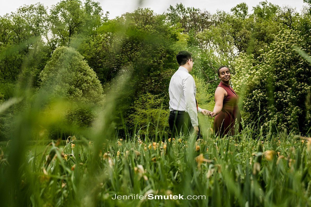couple walking Cylburn Arboretum Engagement Session