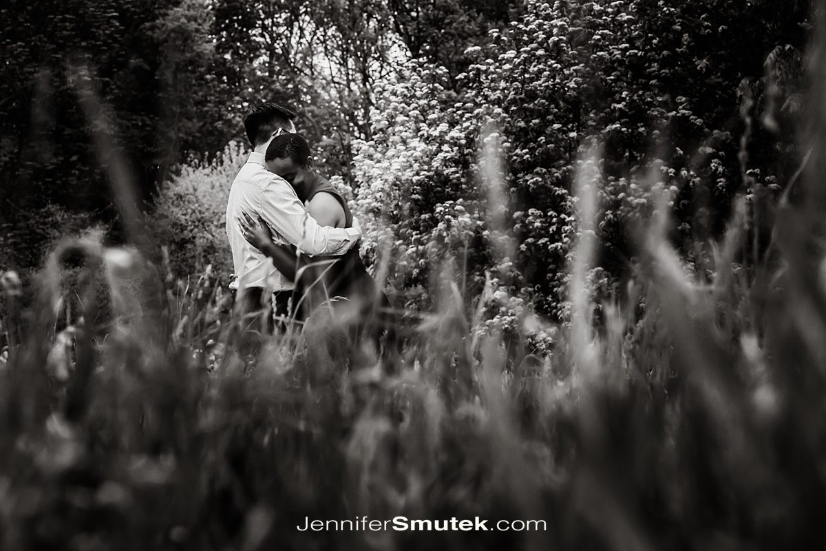 black and white photo of couple hugging