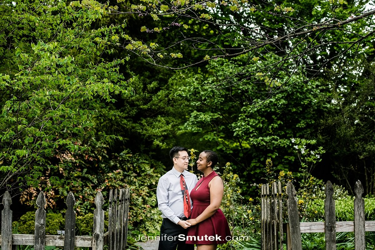 couple standing in fence