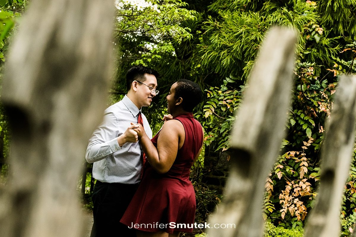 couple dancing behind fence