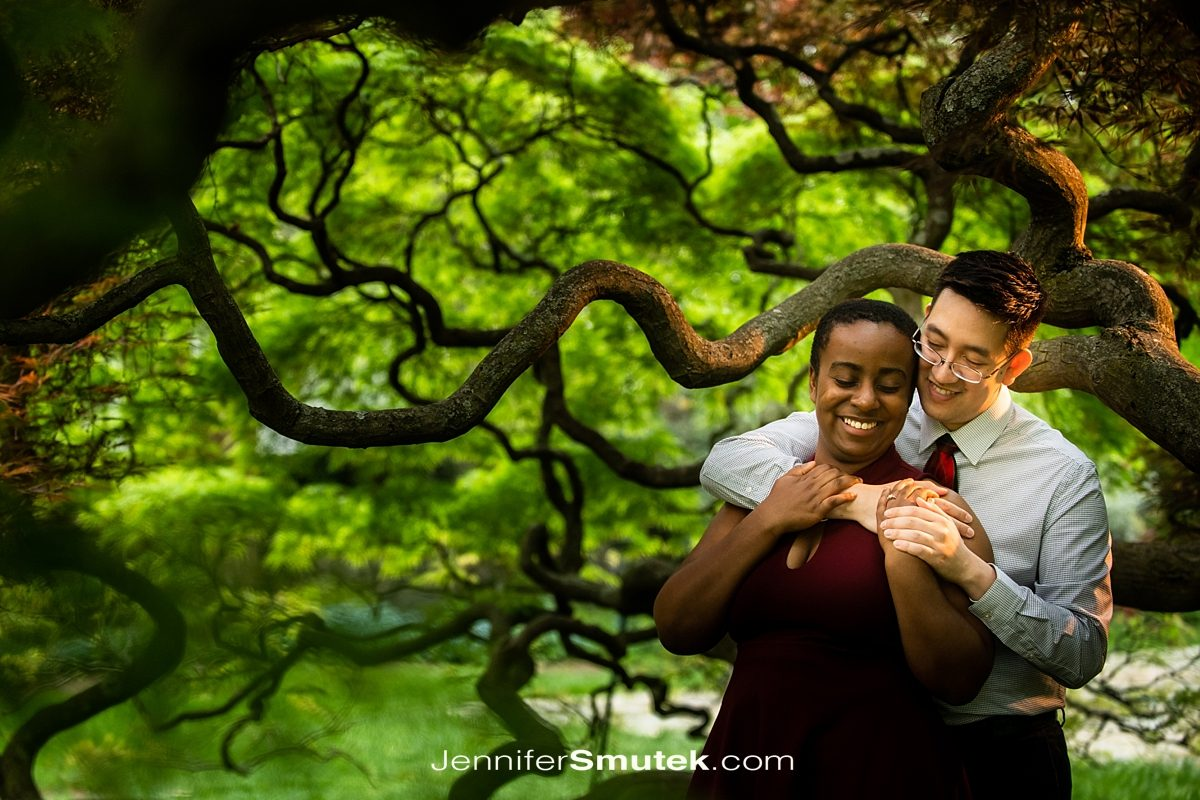 couple in a tree at Cylburn Arboretum Engagement Session