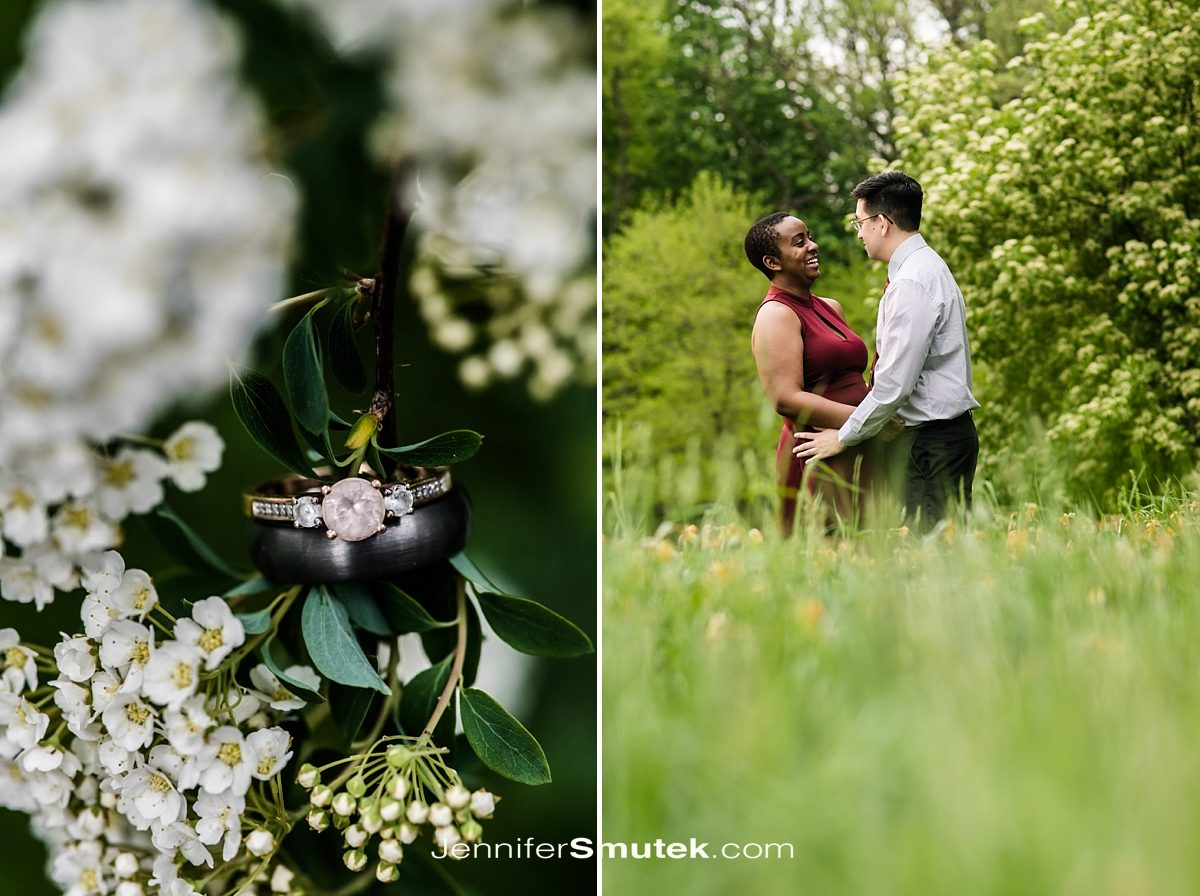 couple laughing in field with engagement ring