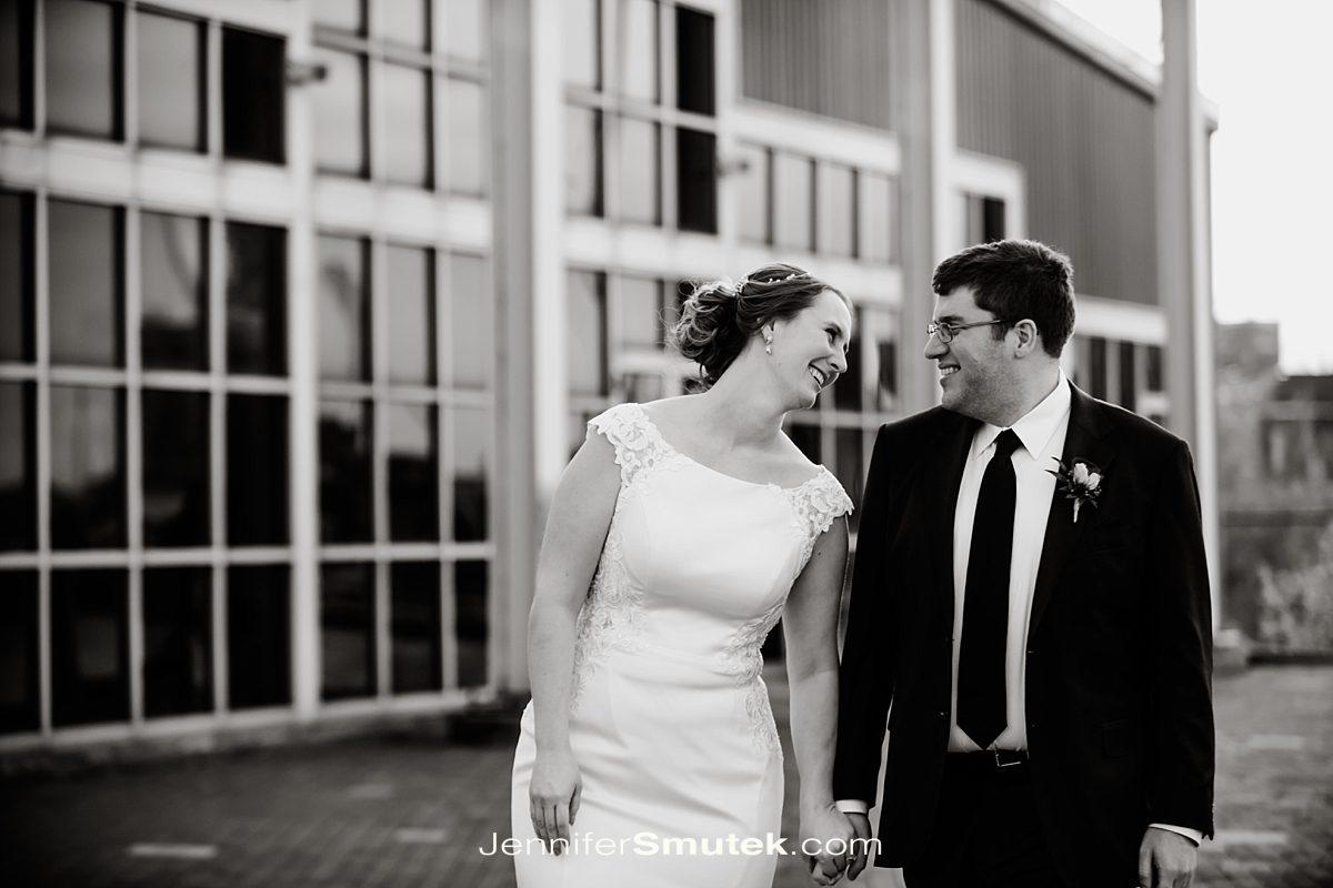 black and white photo of couple walking