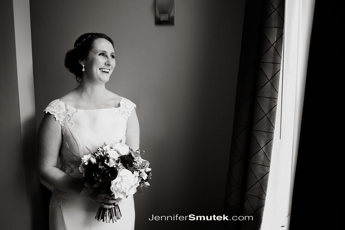 bride in window light at the hotel indigo in baltimore