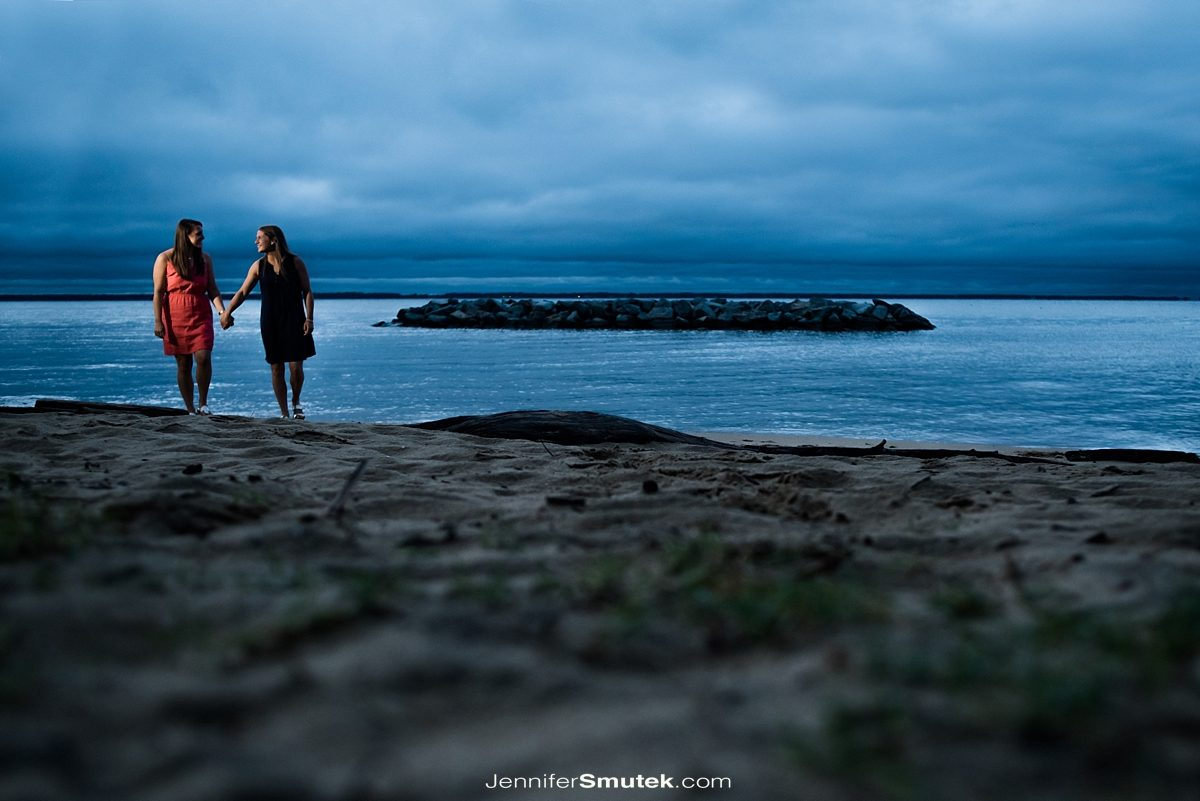 annapolis engagement session of two brides walking along the beach