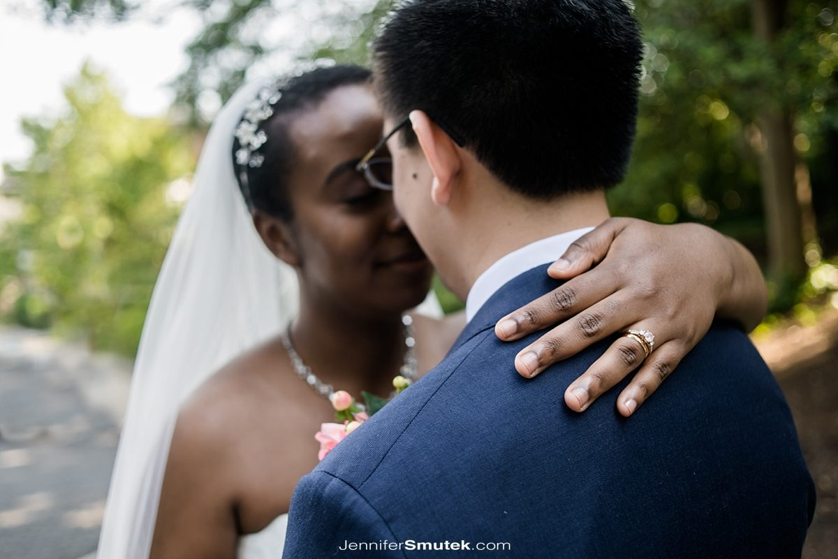 newly married couple embraces DC wedding photographer