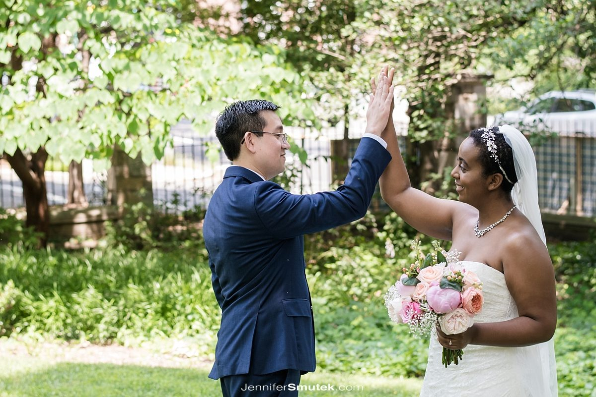 couple high-fives getting married