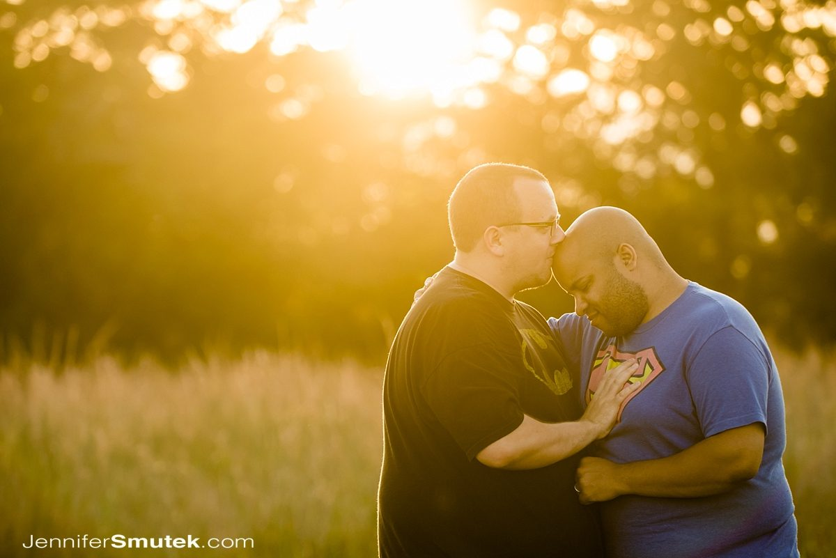 sun flair photo of two grooms in a field