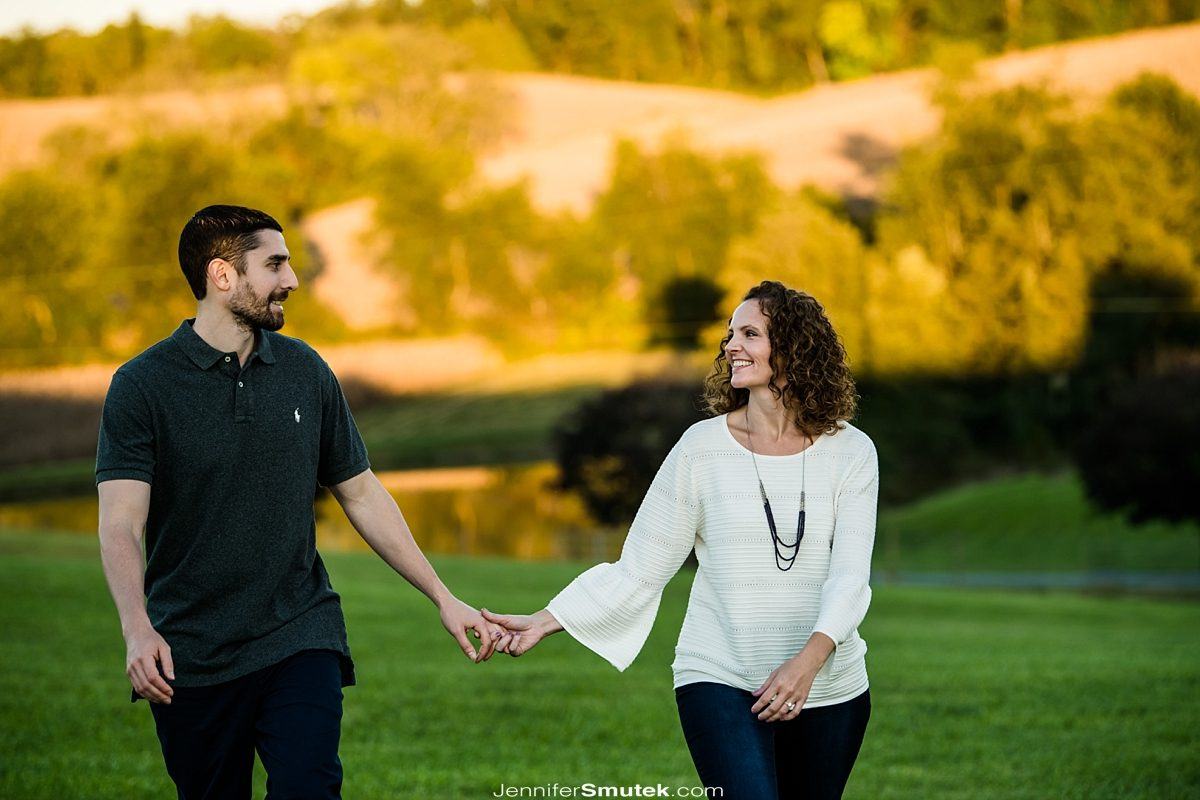 couple walking at linganore wine cellar engagement session