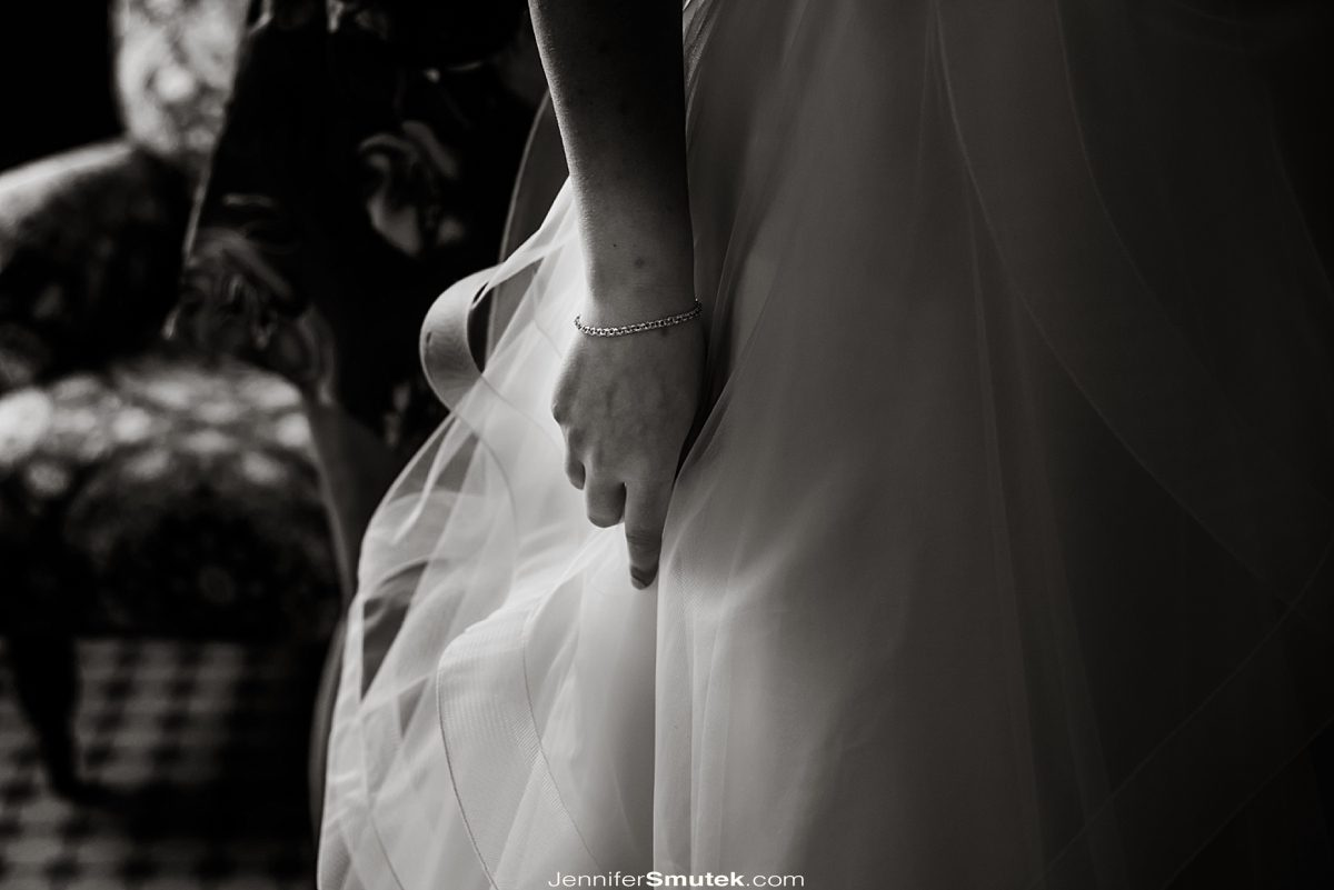 brides hand on her gown
