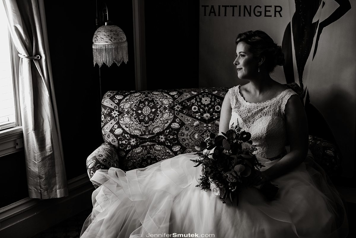 black and white photo of bride wearing a boat neck lace gown