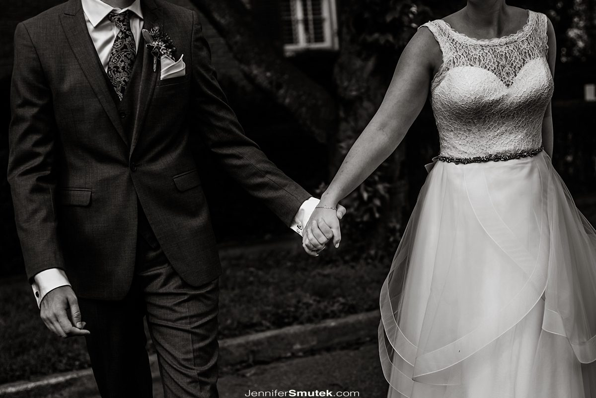 black and white photo of bride and groom holding hands baltimore wedding