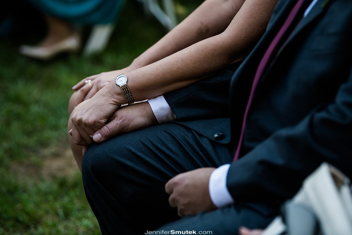 parents holding hands during a baltimore wedding