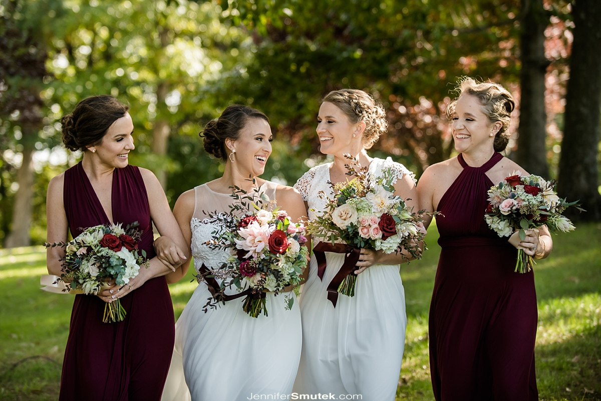 two brides with bridesmaids