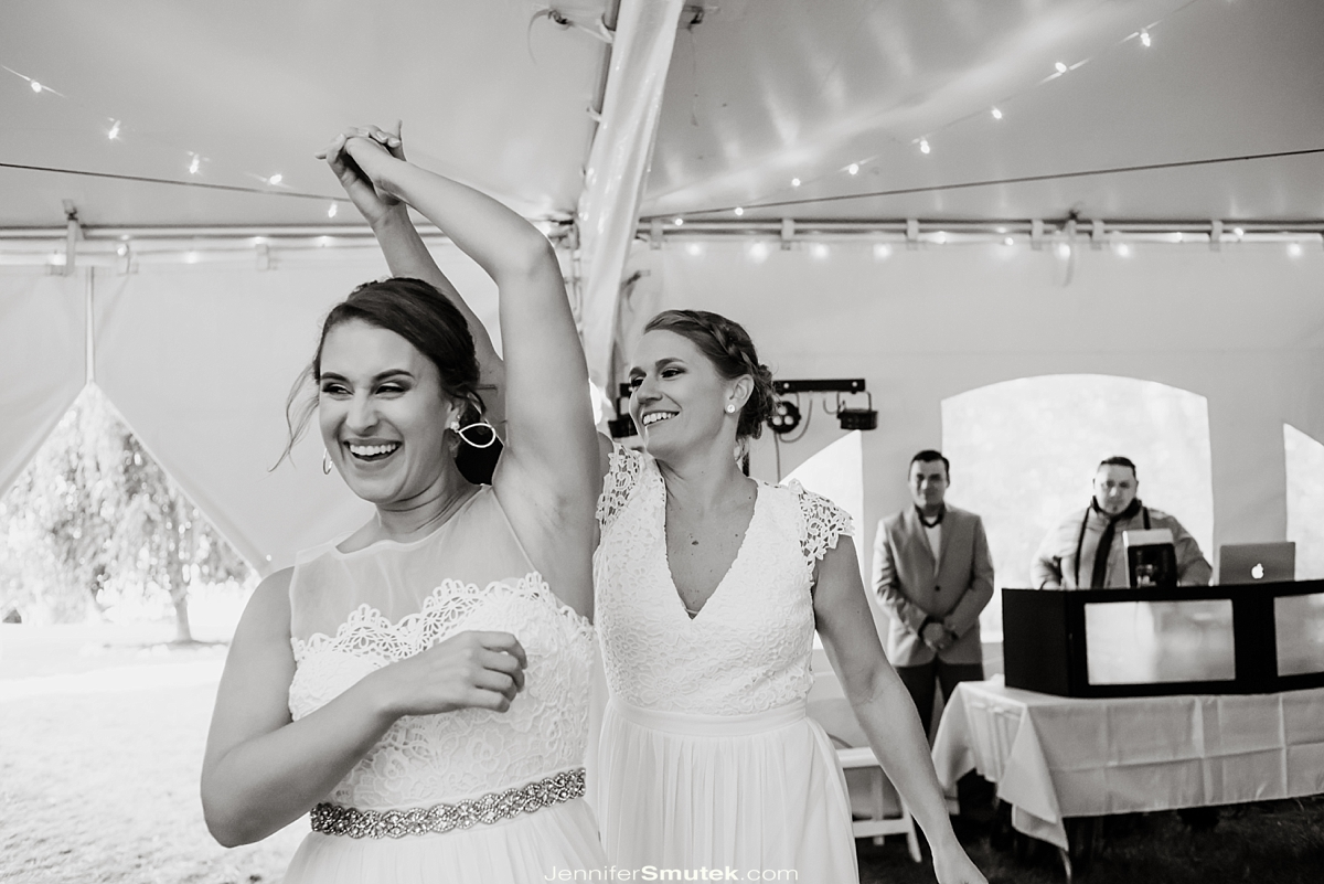 two brides enter wedding reception