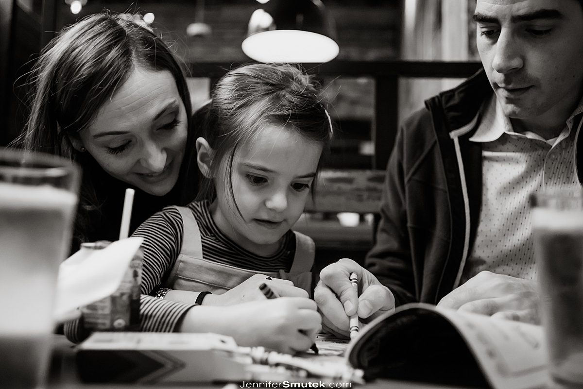 black and white photo of family coloring at Comet Ping Pong Engagement Session,