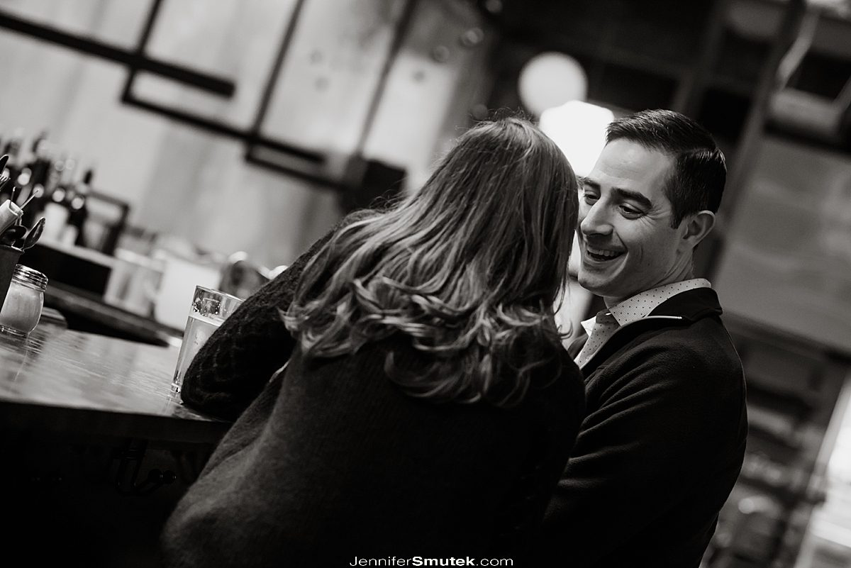 couple laughing at bar maryland engagement photos
