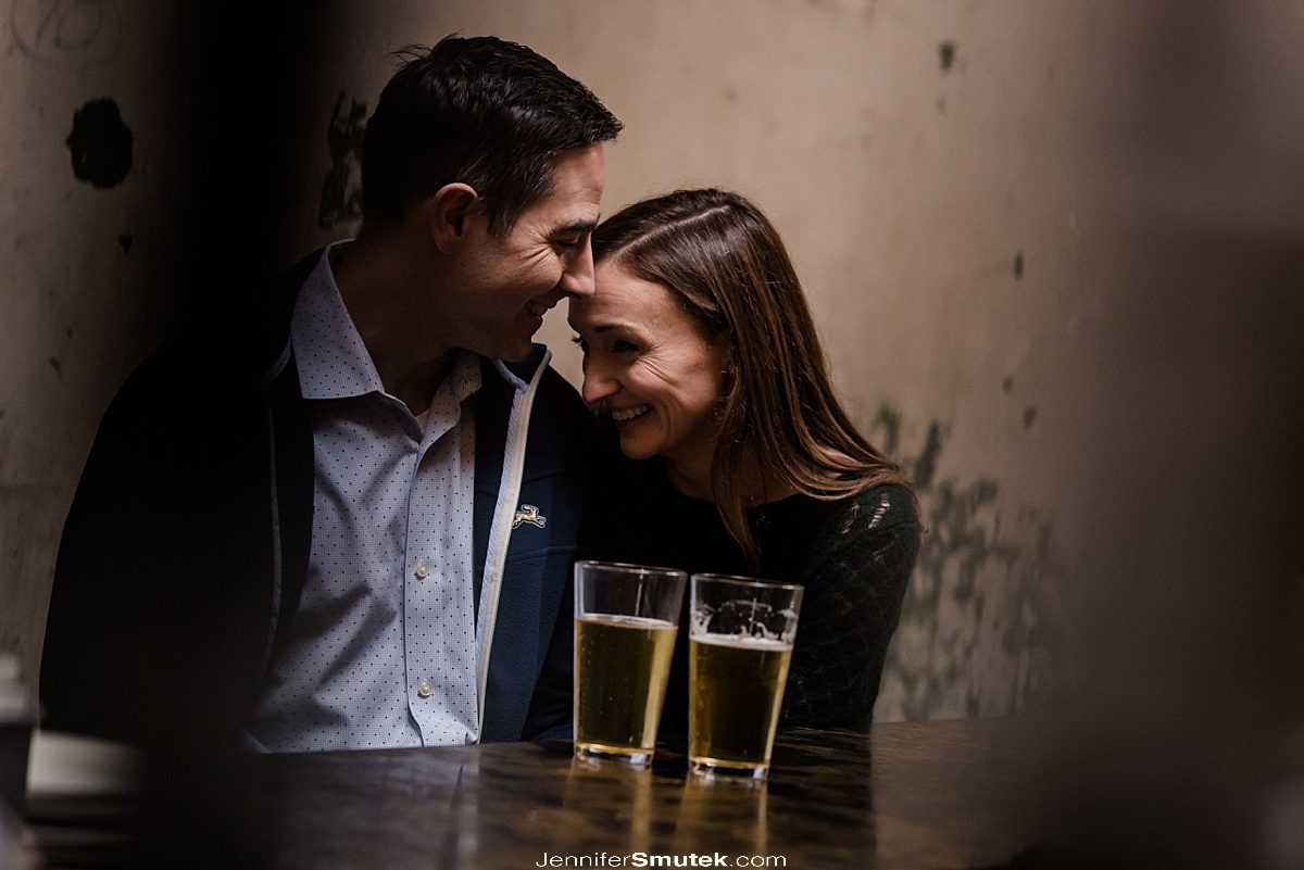 couple laughing at the bar maryland engagement photos
