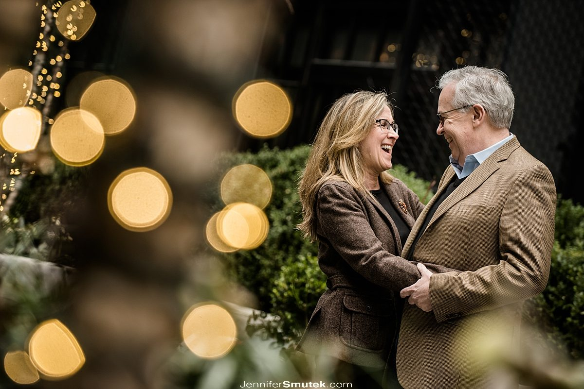 couple laughing at Pendry hotel engagement session in fells point