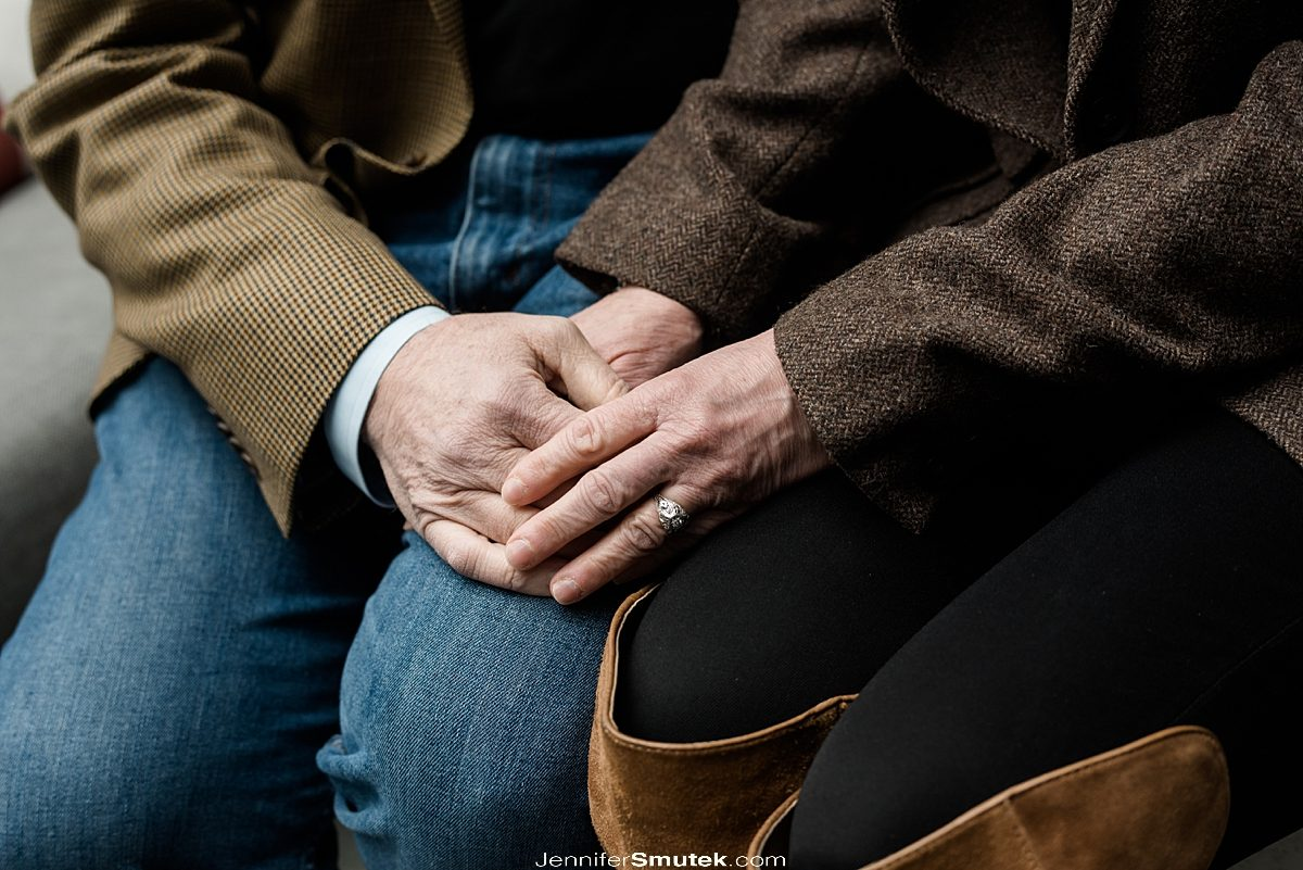 couple holding hands at Pendry hotel engagement session in fells point