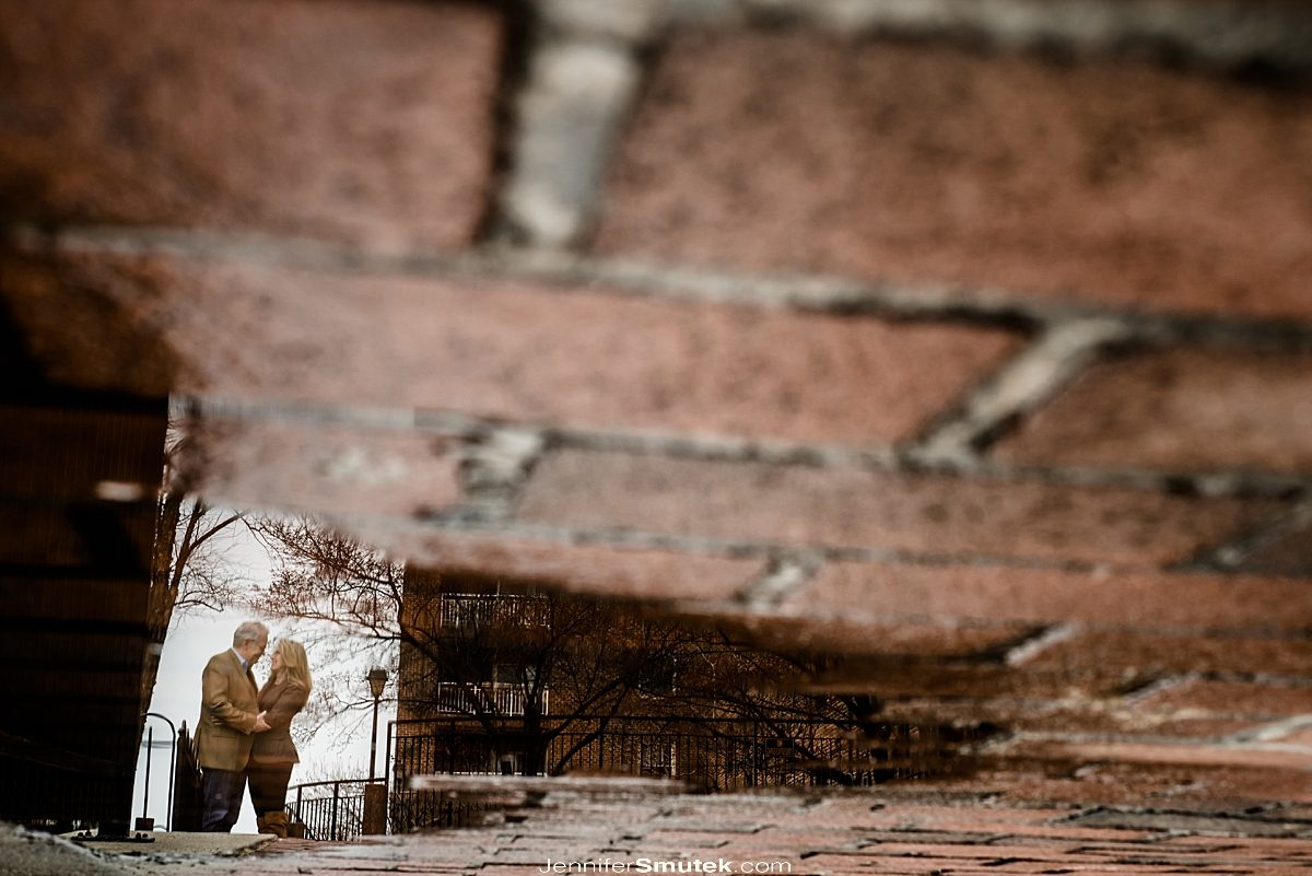 reflection of couple in puddle fells point engagement session