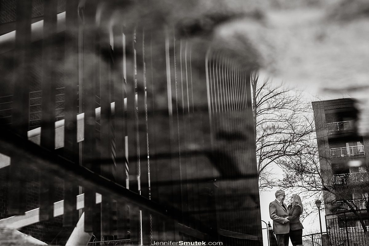 black and white reflection of a couple in a puddle fells point engagement session