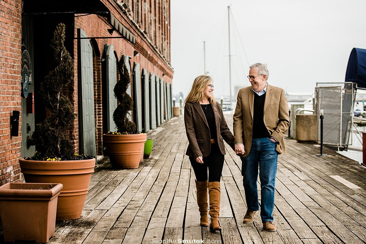 couple walking fells point engagement session