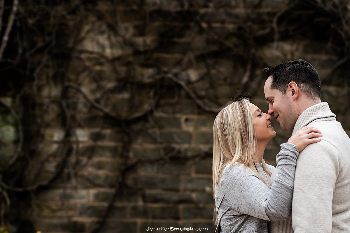 couple going in for a kiss on their engagement session