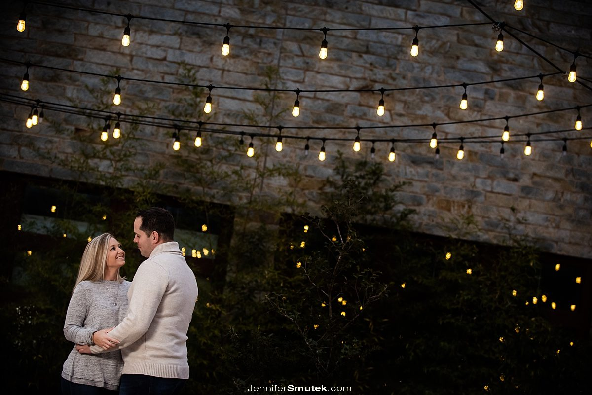 OCF lit couple under bistro lights