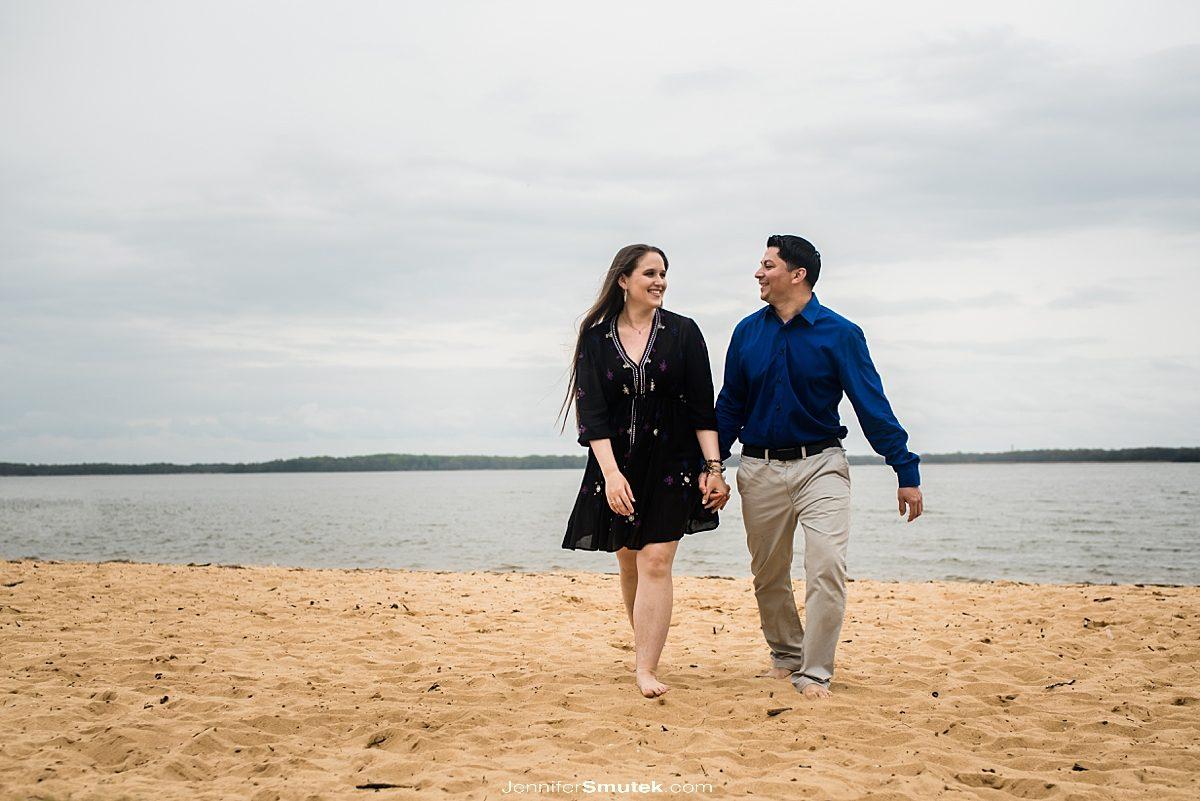 couple walking along the beach at gunpowder state park
