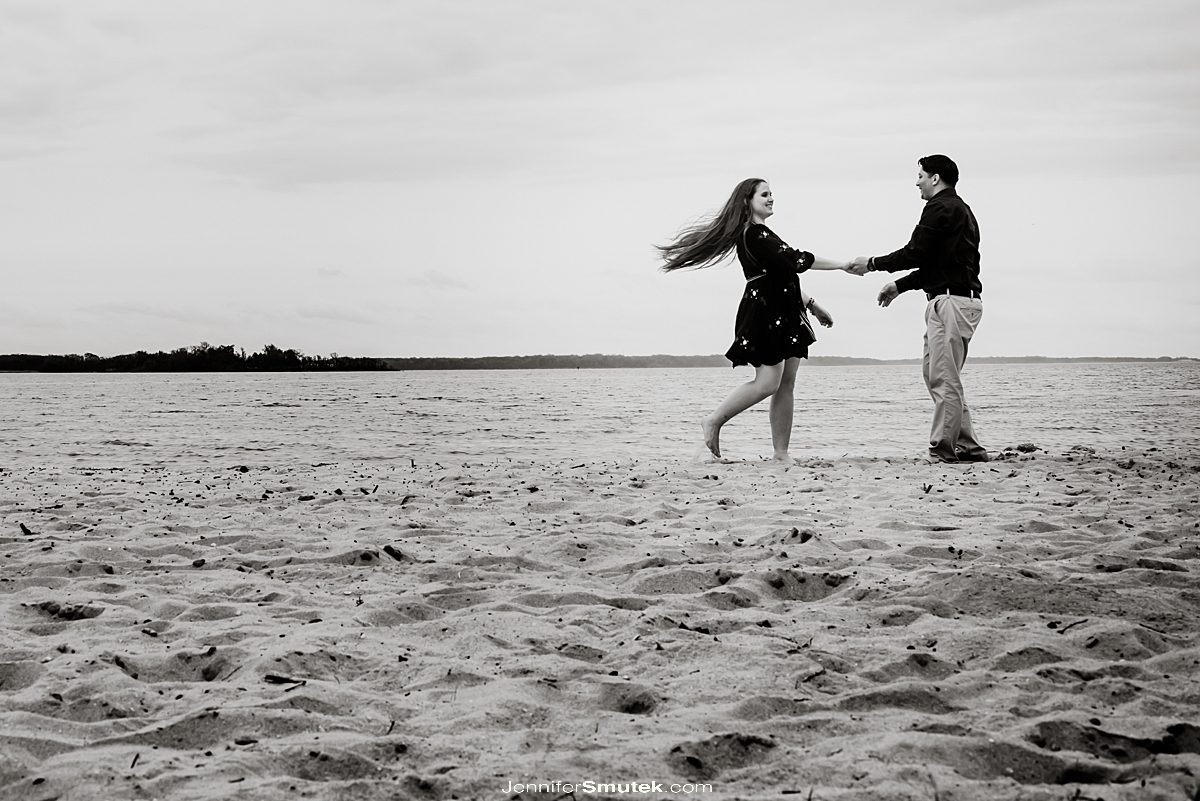 couple on the beach engagement photos in maryland dancing