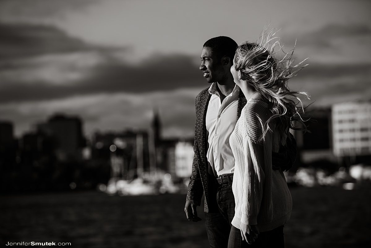 couple looking over the baltimore skyline on engagement session