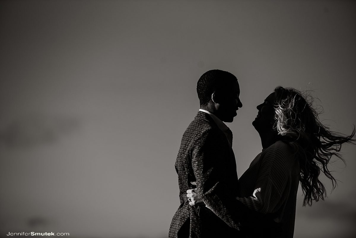 black and white photo of couple laughing by the water South Baltimore Engagement Session