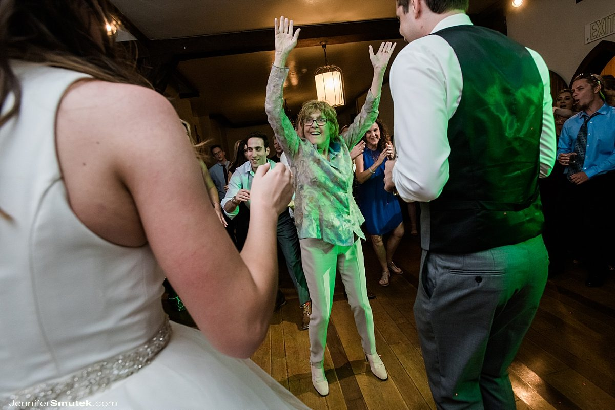 woman dancing at wedding with bride and groom in baltimore