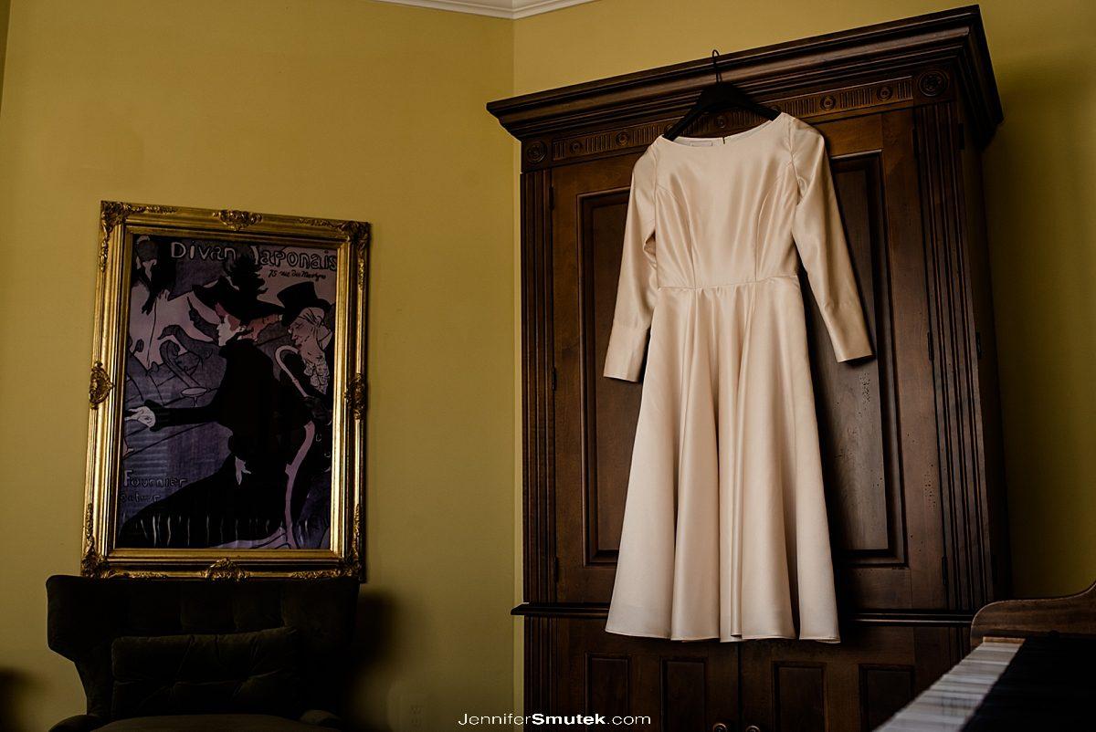 wedding dress hanging on wardrobe