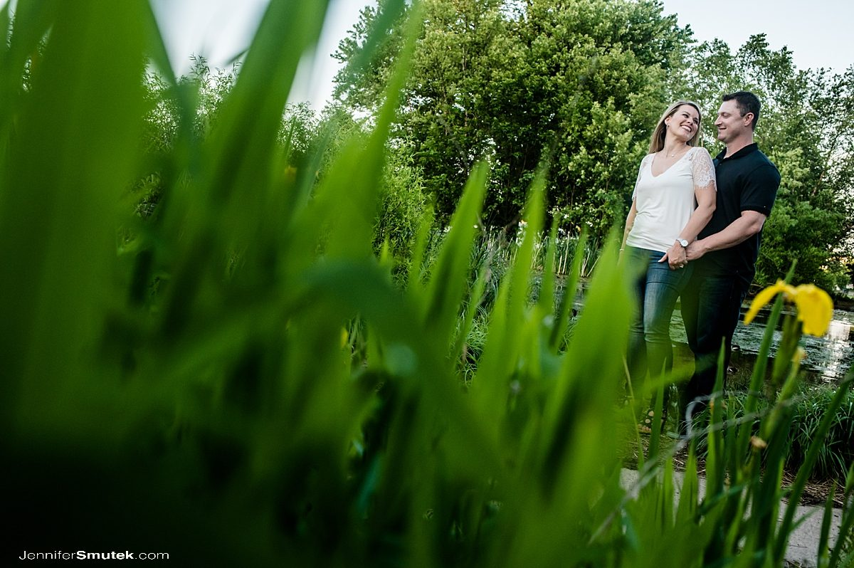 couple standing behind grass in baltimore engagement session