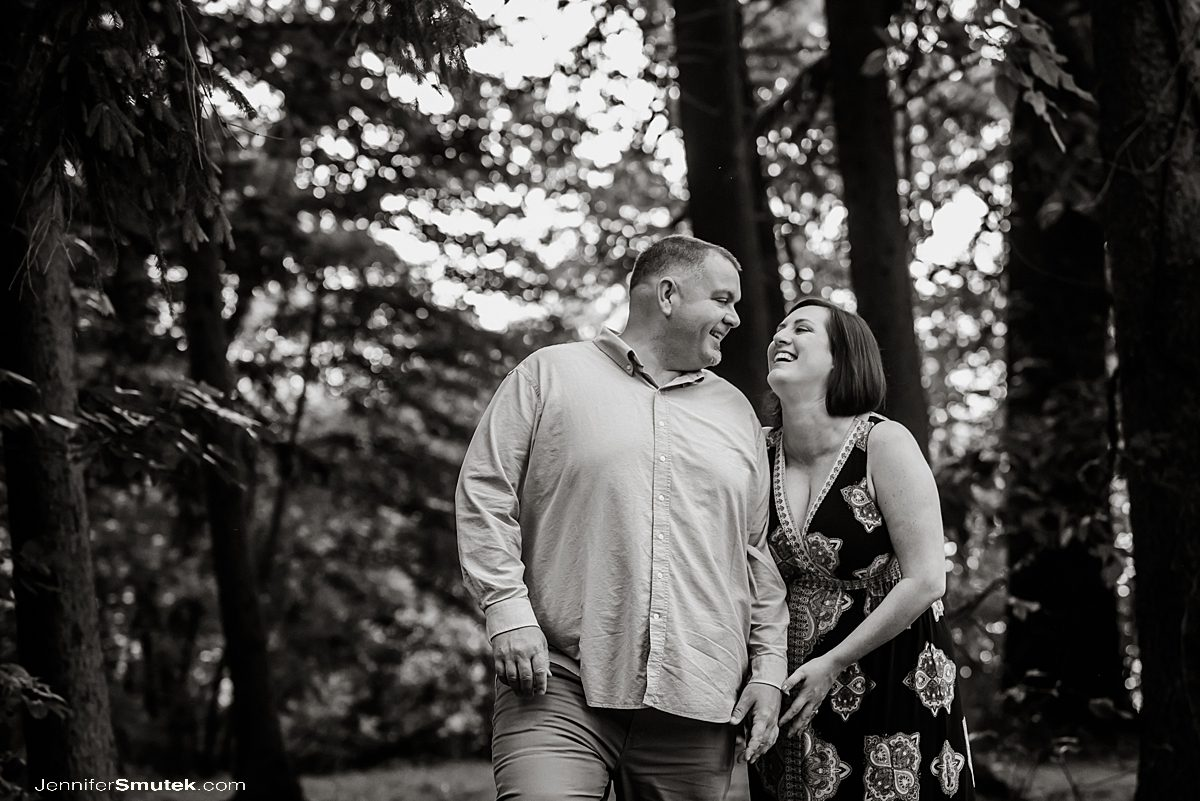 black and white photo of couple laughing baltimore engagement session