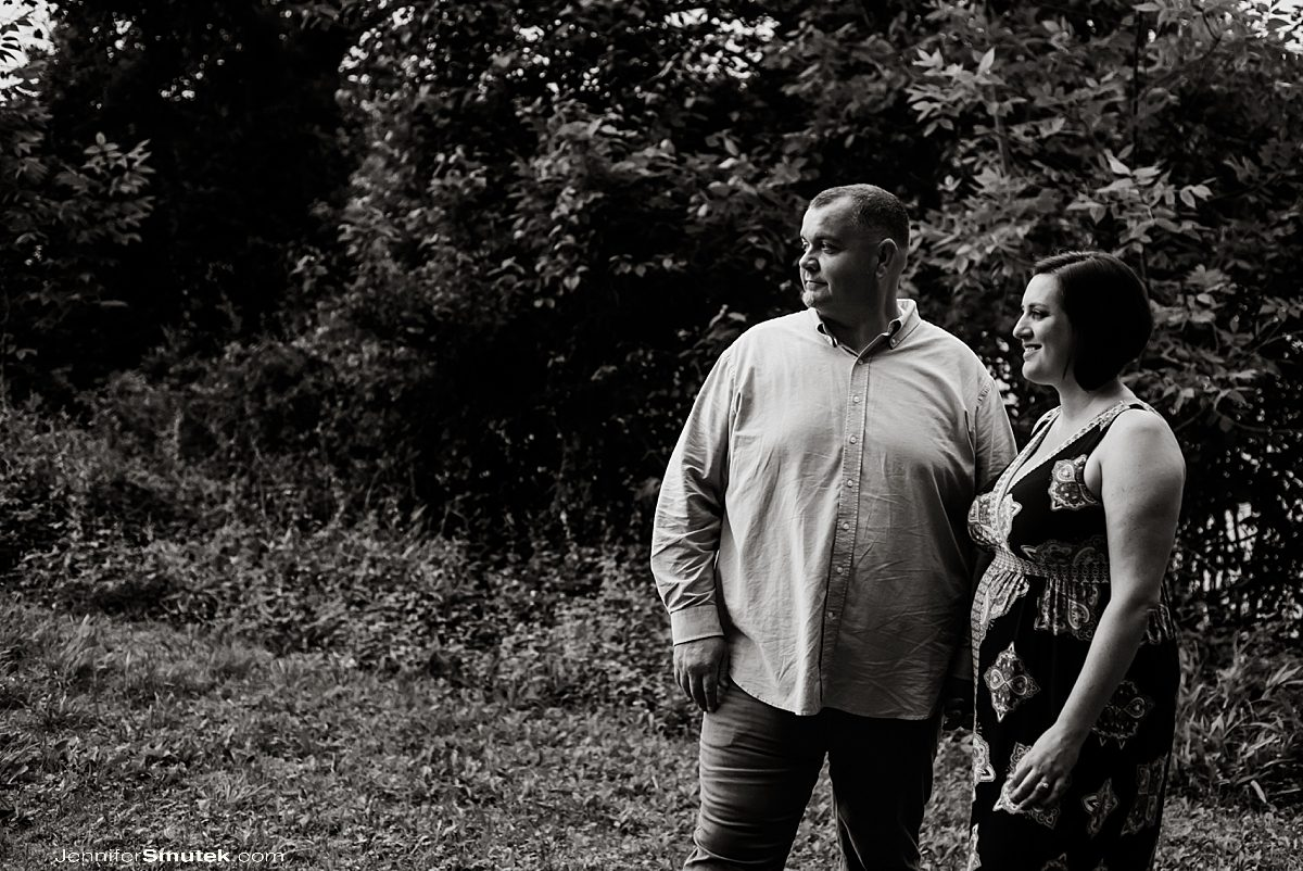 black and white photo of couple looking off into the distance