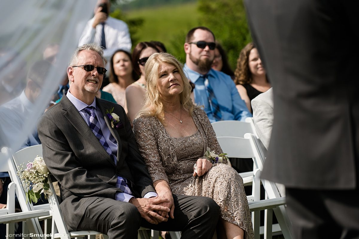 parents watching bride get married