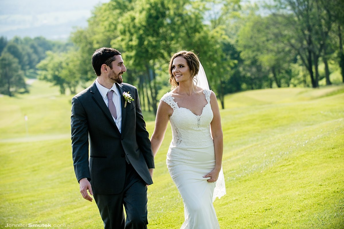 bride and groom walking on golf course maryland wedding