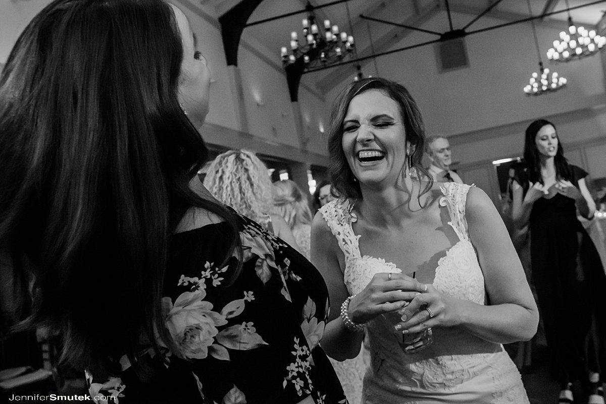 bride dancing and laughing on the dance floor