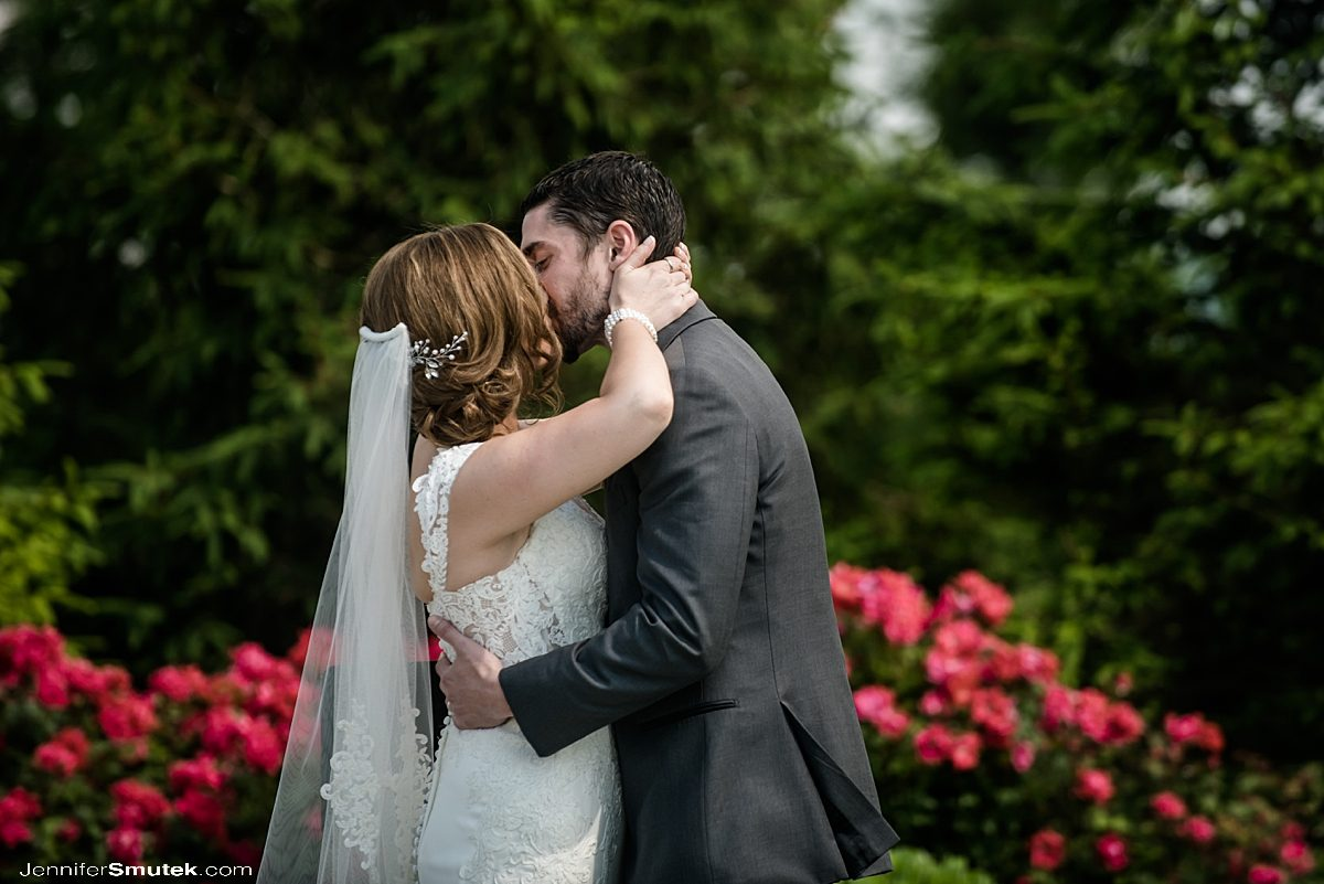 bride and groom kissing Musket Ridge Golf Club Wedding