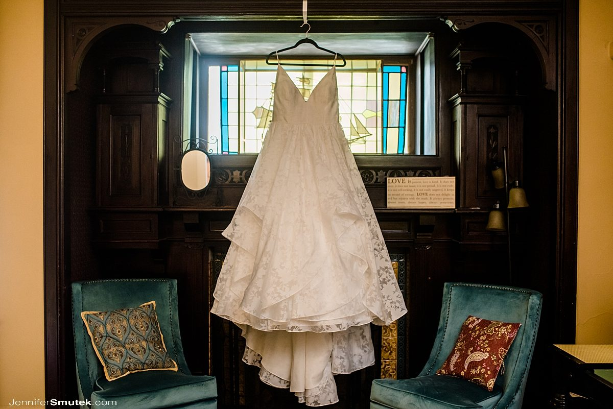 wedding gown hanging on fireplace