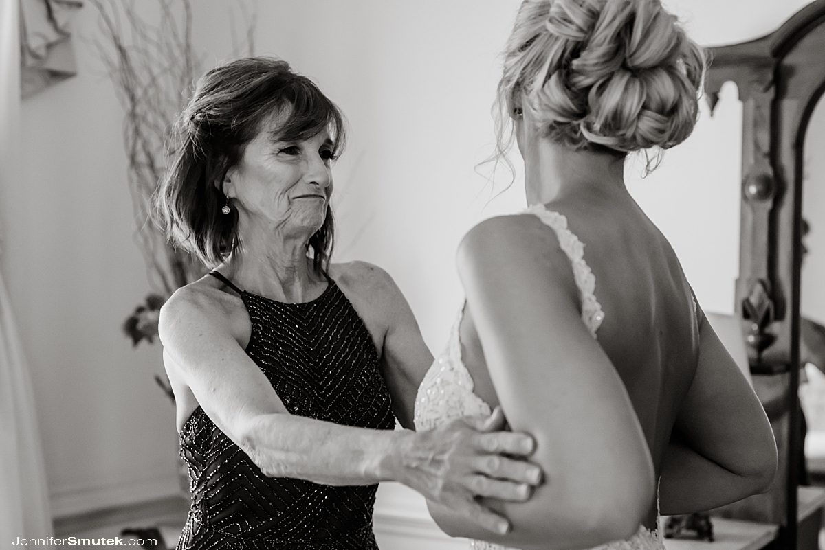 mother of bride smiling at bride