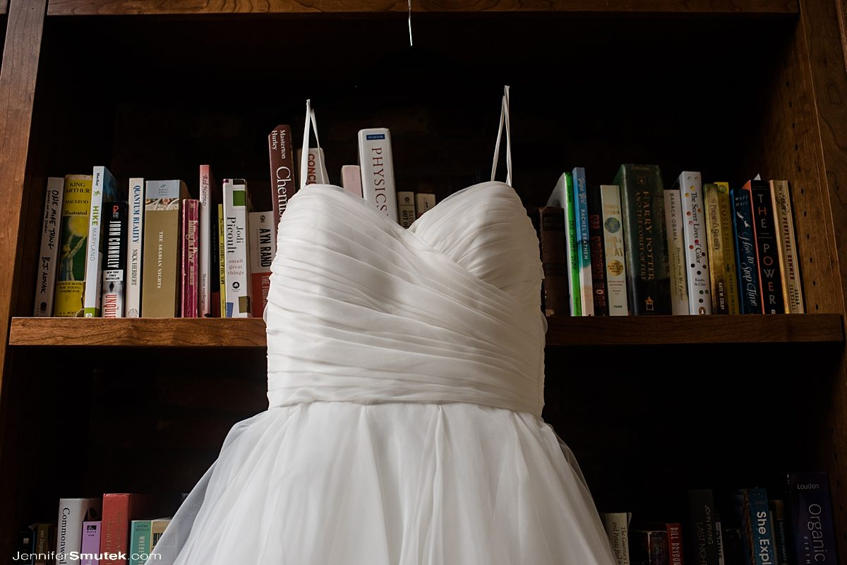 wedding gown hanging on custom made book shelf