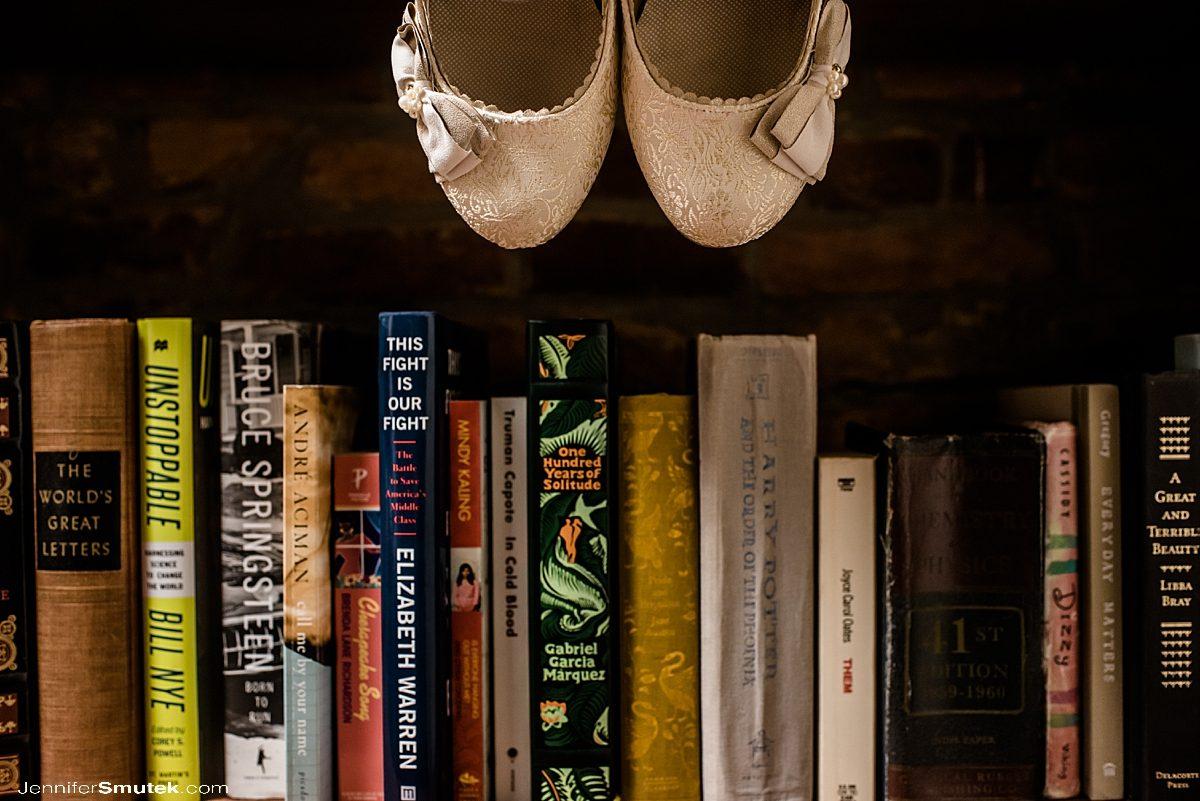 wedding shoes on bookshelf
