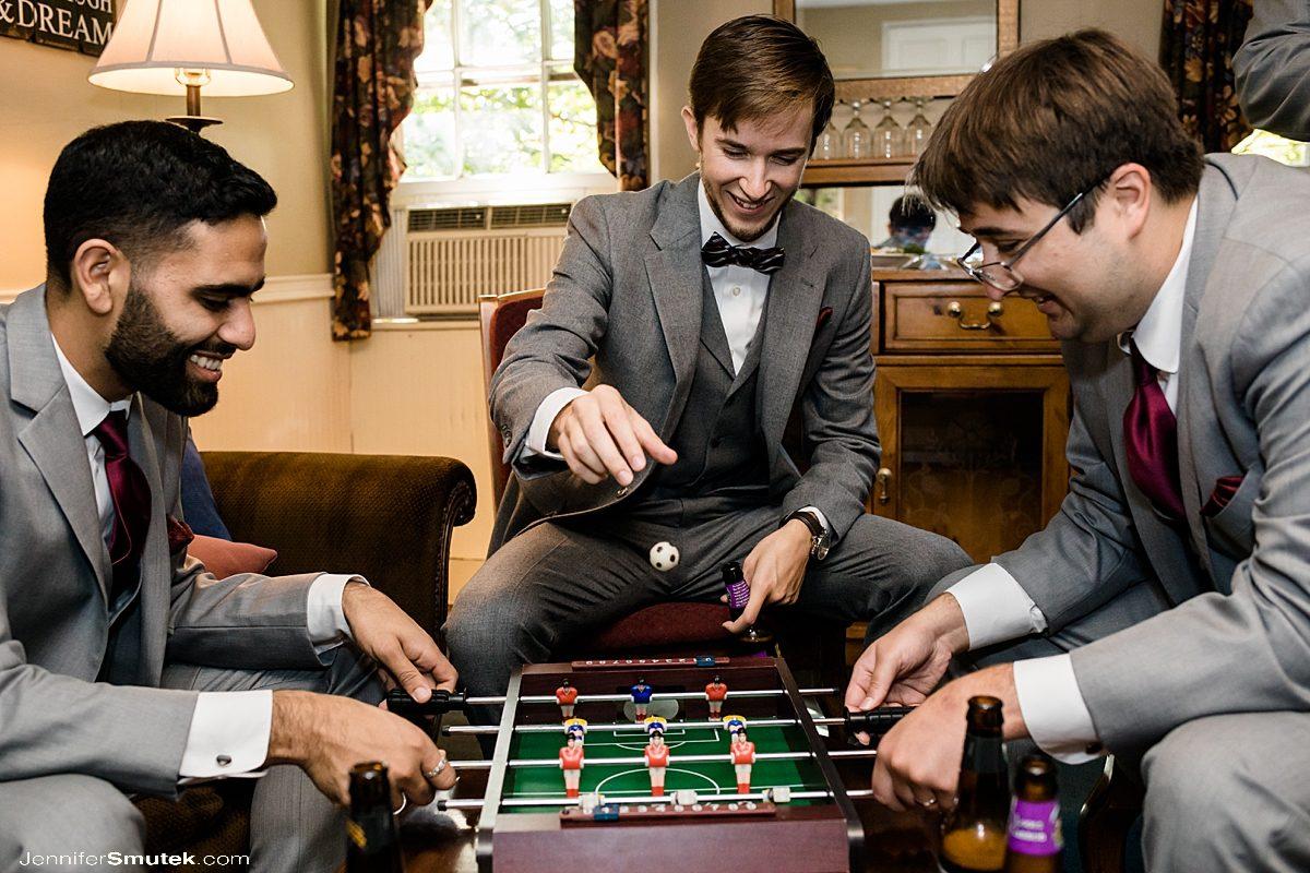 groom playing a game at elkridge furnace inn wedding