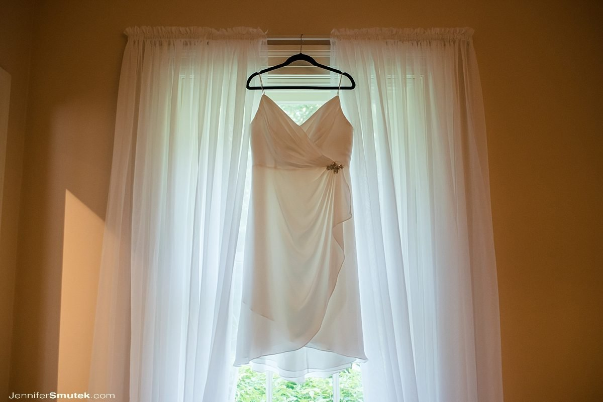 dress hanging in window for Intimate Weekday Elopement at the Liriodendron